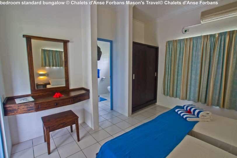 bedroom-standard-bungalow-©-Chalets-dAnse-Forbans-Masons-Travel