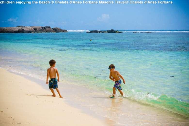 children-enjoying-the-beach-©-Chalets-dAnse-Forbans-Masons-Travel