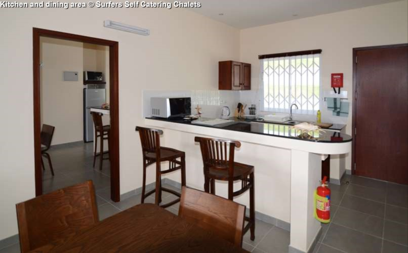 Kitchen and dining area Surfers Self Catering Chalets (Mahe)